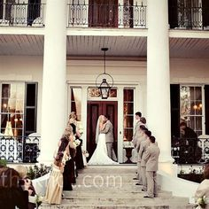 The ceremony took place on the front steps of the plantation...a Southern Wedding in Natchez.  http://www.visitnatchez.org/weddings/