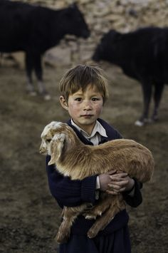 stevemccurrystudios:  Hazara child holds a young goat in Bamiyan Province, Afghanistan.