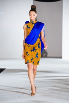 Ozora Showcasing a blue & Yellow print dress at Africa Fashion Week London 2011.