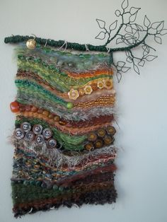 An August Walk in the Woods Woven Wall Hanging ~ Grace Mahoney Weaving with wire, buttons and beads. An August Walk in the Woods Woven Wall Hanging ~ Grace Mahoney… Weaving Textiles, Weaving Art, Tapestry Weaving, Loom Weaving, Fabric Weaving, Fabric Art, Fabric Crafts, Art Fil, Cloth Paper Scissors