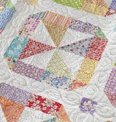 Kaylene Parry machine-quilted small- and large-scale feather designs in the blocks and borders. She stitched a teardrop vine in the sashing strips and a floral motif in each sashing square.