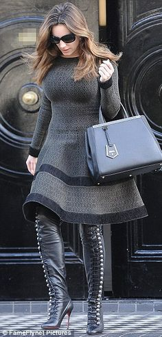 Kelly Brook curves in figure hugging dress and over the knee high heel boots ~Latest Trendy Luxurious Women's Fashion - Haute Couture - dresses, jackets, bags, jewellery, shoes etc.