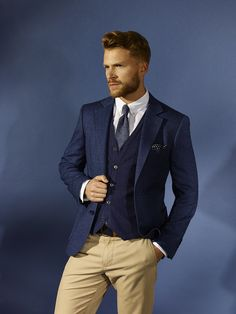 Navy blazer, navy sweater, white dress shirt, and tan pants with navy knit tie…