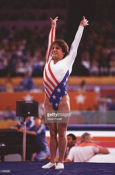 Gymnast Mary Lou Retton of the USA raises her hands in celebration as she salutes the crowd following her performance in the women's floor exercise competition at the 1984 Summer Olympic Games in Los Angeles, California, USA. Mandatory Credit: Steve Powell/ALLSPORT