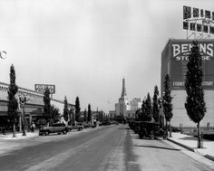 Wouldn't it be great if Beverly Hills was still like this? Popular, but not packed. Worth going to, but not so that parking is impossible. In this photo we're looking southeast along Canon Drive toward the Warner Bros. Theater on Wilshire Boulevard in Beverly Hills in 1936. That sign on the left—Auburn Cord—was for an American brand of automobile that went out of business the year after this photo was taken.