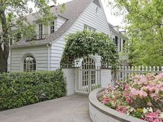 I absolutely love this entrance....fence/privacy/painted brick