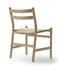The chair was designed by Hans J. Wegner and is classic Danish design at its finest. Read how he was inspired by the Shaker movement. Danish Furniture, Modern Furniture, Furniture Design, Oak Dining Chairs, Wishbone Chair, Wood Design, Chair Design, Solid Wood, Inspiration