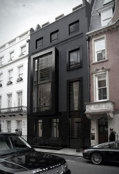 bold in black // #architecture #modern Love this! Great conversation between the old and #installation architecture #cotage #built environments