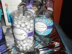 Frozen dessert table including a custom candy bar using blue, white and lavender candies.  Designed by B. Lee Events.  Candy by Oh Nuts! (www.ohnuts.com).  Frozen dessert tags by Custom Event Creations (www.etsy.com/shop/CustomEventCreations)