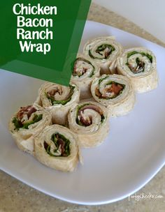 Chicken Bacon Ranch Wrap Bites..Tortillas, Ranch dressing packet  8 oz. cream cheese, Spoonful of sour cream, Bacon – cooked, Chicken, Romaine Lettuce, Tomato (optional). Mix ranch packet, cream cheese, and sour cream together in a bowl.   Spread the ranch and cream cheese mixture all over the tortilla.  Layer bacon, chicken, and romaine on one half of the wrap and roll er' up.   If you want to make them into bite sized pieces, roll tightly and then slice.