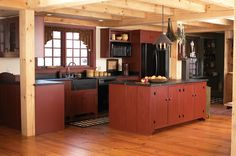 Aaaahhhh......Colonial Kitchen with soapstone countertops, barn red cupboards/cabinets, huge pained window over the SOAPSTONE sink.  I think this is my favorite.  Hey, a girl can dream, can't she?