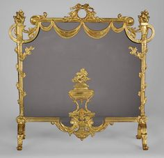 Beautiful antique Louis XVI style gilt bronze firescreen with covered pot and flaming torches decoration #firescreen #louis16 #style #french #frenchantiques #bronze #MarcMaison #fireplace