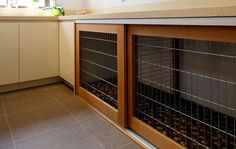 Dog Crates built into the decor... great for a pet/mud room.