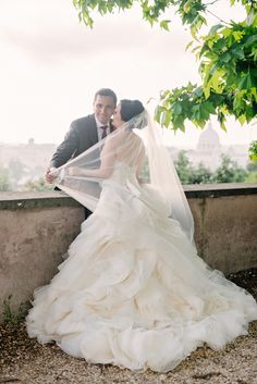 A spectacular location requires a spectacular wedding gown! ~from #Lazaro | On SMP Destination Weddings -- http://www.StyleMePretty.com/little-black-book-blog/2014/01/27/rome-destination-wedding/ Rochelle Cheever Photography