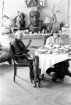 "Lump and Picasso meet for the first time. Mutual love."" [Lump puts his front paws on Picasso's lap. Villa La Californie, 1957.] The Private World of Pablo Picasso, p. 3."