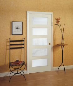 Add value to your home with this increasingly popular five-panel interior door, featuring white laminated glass for light filtration while maintaining privacy.  Stiles are made from laminated wood for excellent screw hold and retention properties.  | McMunn and Yates Building Supplies