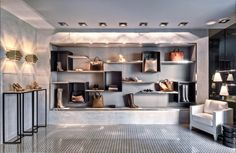 I picked this picture because I like the simplistic design.  The items are displayed on the walls to maximize space and give them full exposure.  The lights also draw emphasis to the items.