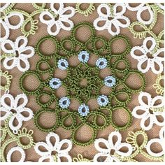 PDF pattern of tatting lace doily tatted-Garland This is PDF pattern, you can use this pattern immediately. Not including printed matters. The pattern is visual chart only. Pattern is written in English. material - 2 shuttles or needle, cotton thread diameter - 28 cm = 11 inch (when