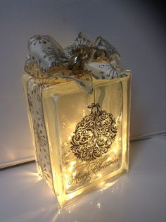 """""""Merry Christmas Holiday Ornament"""" laser etched in gold, with gold/silver ribbon embellishment and LED battery operated warm lights to add an extra special touch to your holiday decor....personal message me for color details if you are interested in this design for yourself or as a gift for that special someone. Laser etching by Lavene & Co."""
