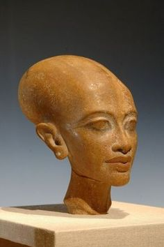 """Portrait bust of a DAUGHTER of King AKHENATEN + Nefertiti: Meritaten (http://en.wikipedia.org/wiki/Meritaten) • ELONGATED skull shape was idolized during Akhenaten's rule • due to genetic Defect or """"Ancient Aliens""""?  those are the common myths. but it's most probably simply artistic style or unisex philosophy or the tight binding on heads - the Nubian tradition equivalent of Chinese shortening of girl's feet as """"aesthetic"""" ideal"""