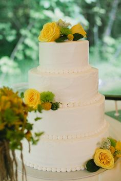 Four Tier Round Wedding Cake With Yellow Flowers