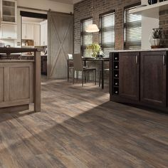 Style Selections 5.43-in W x 47.72-ft L Spalted Woodbark Plank Laminate Flooring Item # 791596 Model # LX10700944 $1.49 sq/ft
