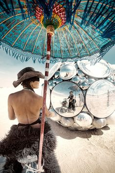 Photo by Christopher Michel, Burning Man 2012.  Really beautiful parasol & that art piece is magical