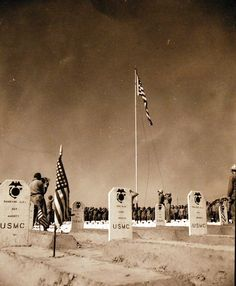 Battle for Iwo Jima, February-March 1945. The Flag is Raised – Over the 4th Division Cemetery. Photographed by Gillespie, March 1945. U.S. Marine Corps photograph, now in the collections of the National Archives.