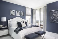 Sherwin Williams Indigo Batik The master bedroom is saturated in a rich dusty navy blue with a white bed and night tables that pop against the wall color Blue Bedroom Paint, Blue Master Bedroom, Best Bedroom Colors, Blue Bedroom Decor, Bedroom Color Schemes, Home Bedroom, Indigo Bedroom, Navy Bedroom Walls, Design Bedroom