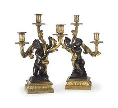 A PAIR OF FRENCH ORMOLU AND PATINATED BRONZE THREE-BRANCH CANDELABRA   FIRST HALF 19TH CENTURY.