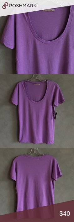 39 SIXTYONE @ VELVET Lavender Scoop Neck T-Shirt This scoop neck t-shirt by 39 SIXTYONE @ VELVET (by Graham & Spencer) is a soothing lavender color. It's made of 100% cotton and is super soft and stretchy. Size small and true to size. This top is a production sample and it has not been previously sold in retail (or worn). No flaws or defects. Velvet Tops Tees - Short Sleeve
