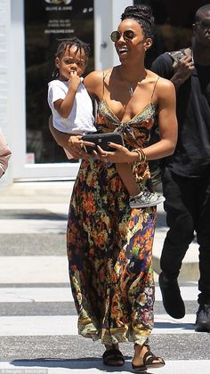 Doting mother: Kelly Rowland stepped out with her son Titan for a day out in LA on Saturda...
