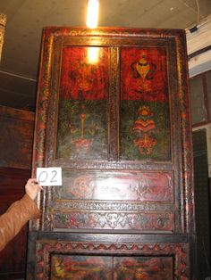 Hand painted pine offering cabinet from Tibet, China