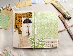 Working in my art journal, the beginnings of a new mixed media spread, the first layer of vintage papers, including a lovely mushroom!