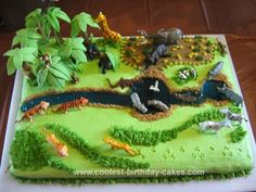 Homemade Safari Cake: This Homemade Safari Cake was made for my 7 year old's safari party. She picked the plastic animals she wanted on the cake. This is a large sheet pan single