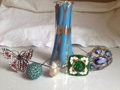 Turquoise-ish blue sterling overlay hatpin holder with some of my favorite hatpins.