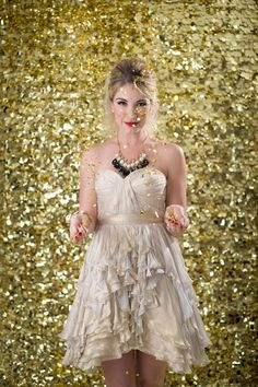 Gold glitter  Styling- Beth Chapman   The White Dress by the shore  Photo- Justin & Mary  Beauty- Jennie Fresa   Dress- Ivy & Aster  Necklace- Aquinnah