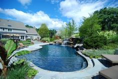 Would love to have a pool that looks like a mountain lake with a beautiful rock waterfall... oh, to dream!