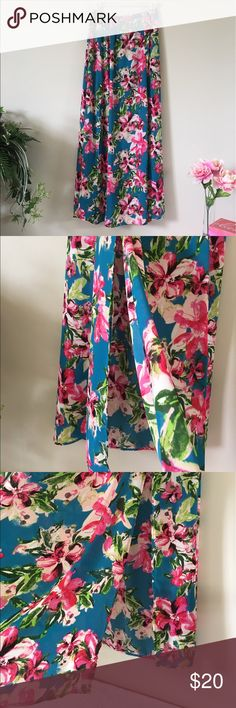 🆕🌴🏖PRETTY FLORAL MAXI SKIRT🛳🌴🆕NWT/USA SIZE S But would fit M better  Meas. 13 in. across flat &  easily stretches to 17 in. Falls 40 in. down Turquoise w/a floral blend of pinks, peaches, greens & some black Double slits skirt for a jazzy style, Show off those sexy legs Built-in turquoise halfslip High waisted Gathered waistline 100% Poly Perfect for the Island life style. Very versatile BN & comes in online pkging. Peach Love Skirts Maxi