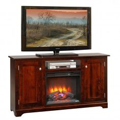 "Amish Latimer 61"" Electric Fireplace TV Stand This TV stand electric fireplace combination lights up the room with style and warmth. A fireplace without the clean up, a TV stand with built in storage, and all in your choice of wood and finish, handcrafted just for your home."