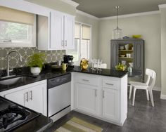 This look is created by dark ceiling to match backsplash/wallpaper...neutral walls,,,and white trim..calming & clean