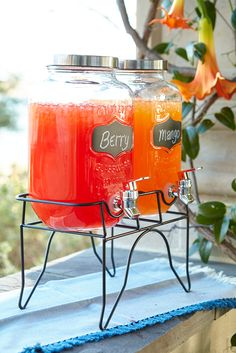 Pier 1's rustic farmhouse-style Chalk Note Drink Dispenser lends a touch of country (French or American) to your kitchen, porch or patio. Twin lidded Mason jars feature tap spigots and chalkboard labels for you to write on, while a wrought iron stand lifts things to a comfortable height for filling glasses or stemware.
