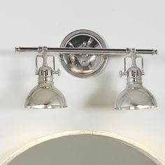 Pullman Bath Light - 2 Light - 2 Finishes Chic, sleek and unique, this vanity light has a sophisticated clean lined look. Our exclusive bath light has steel rotating shades (up and down only), and comes in two finishes: Polished Nickel or Bronze. Vintage Bathroom Lighting, Industrial Bathroom Lighting, Industrial Light Fixtures, Bathroom Light Fixtures, Bathroom Vintage, Bathroom Sconces, Kitchen Fixtures, Home Design, Design Ideas