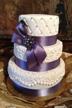 White Scroll Work & Purple Satin Ribbons