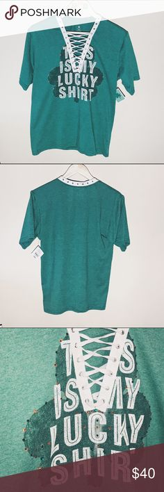 Custom DIY v-neck laced St. Patrick's Day tshirt BRAND NEW WITH TAGS! this  is a custom St. Patrick's day green shirt. the neck has been cut into a v-neck and added eyelets and trim to lace up! trendy! the front of the shirt has added embellishment and rhinestones that sparkle quite a bit! order today, have this is 3 days! siZe small.  💲💲💲BUNDLE➕SAVE💲💲 --- #stpattysday #stpatricksday #shamrock #4leafclover #irish #lucky #green #revamped #lacedup #laced #laces #lf #reconstructed…