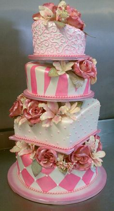 topsy turvy light pink wedding or quinceanera cake