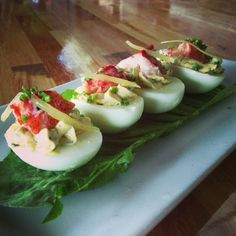 "DEVILED EGGS:  --> Buttered Poached Lobster and Lemon Confit.    ""Adventurous Classic American Comfort Food."""