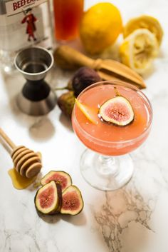 Fig Bees Knees from The Girl In The Little Red Kitchen | Fresh Figs, honey and gin get mixed together to make this pretty pink cocktail.