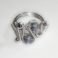 Asymmetric wire wrapped ring tutorial. $2.00, via Etsy.  ...This is different...