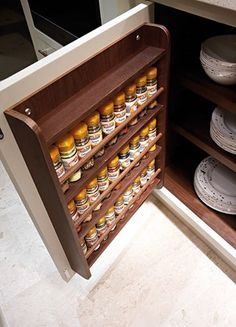 Kitchen Cabinets Storage spice cabinet - bottles were ordered from www.spicebarn